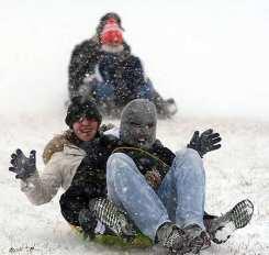 Sledders in Kansas post-storm (AP)