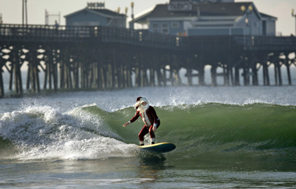 Santa surfs in Cali (AP)