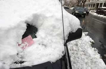 snowed in car gets ticket (LNP picture)